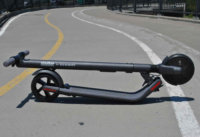 ES2 electric scooter folded on road