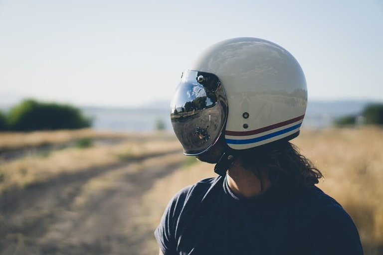 Man wearing electric scooter helmet