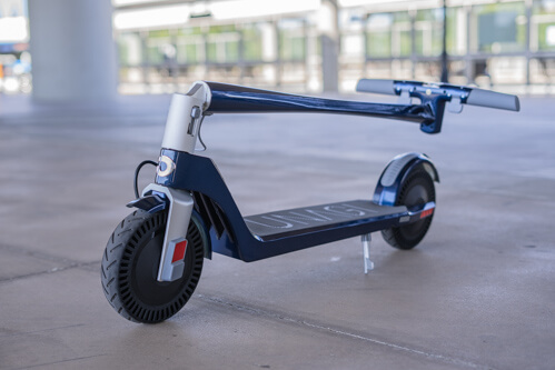 Blue Unagi Model One electric scooter in folded configuration