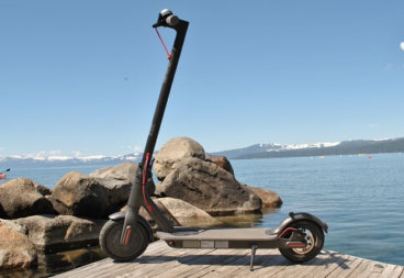 Xiaomi Mi M365 electric scooter on dock of lake