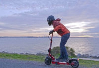 Man accelerating on the Qiewa QPower electric scooter