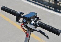Swagtron handlebars and cockpit area with headlight and brake lever