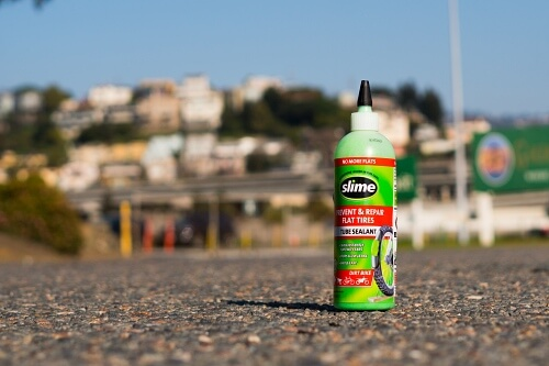 Bottle of green tire slime