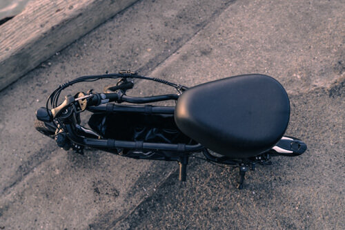 Fiido Q1S Seated Scooter - handlebars folded down, top view of seat and center compartment