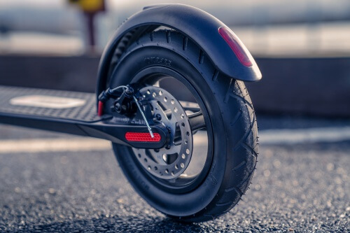 TurboAnt X7 Pro Electric Scooter - Rear tire, rear brake, foot brake, close-up
