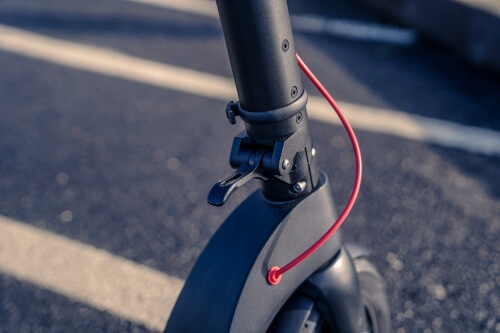 TurboAnt X7 Pro Electric Scooter -folding mechanism on stem, clasp open, close-up