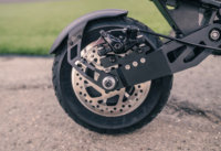 Apollo Ghost electric scooter - rear tire, rear fender, disc brake, swingarm, cropped view
