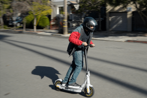 Segway Ninebot Max G30LP Electric Scooter - Man riding scooter, full view, riding to camera