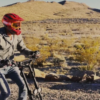 Alex Simon - Zero to Epic - man riding scooter in desert