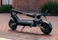 Apollo Phantom electric scooter - scooter, folded, angled view, brick walkway