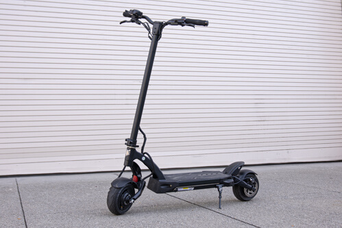 Kaabo Mantis 8 Pro electric scooter - full scooter, garage door backdrop
