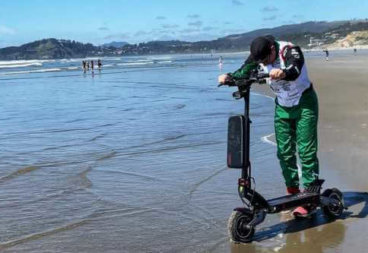 Alex Simon reaching Pacific Ocean with electric scooter