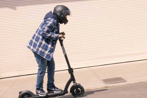 Apollo Air Pro electric scooter - man riding, looks uphill