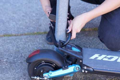Splach Turbo electric scooter - locked to pole