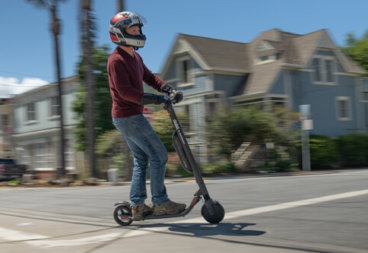 Segway Ninebot ES4 electric scooter - man riding scooter