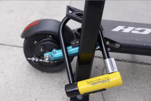 Splach Turbo electric scooter locked to pole, close-up