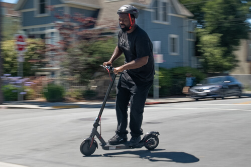Heavier, bigger man riding the Hiboy S2 electric scooter