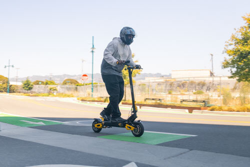 Man riding the VSETT 10+ electric scooter